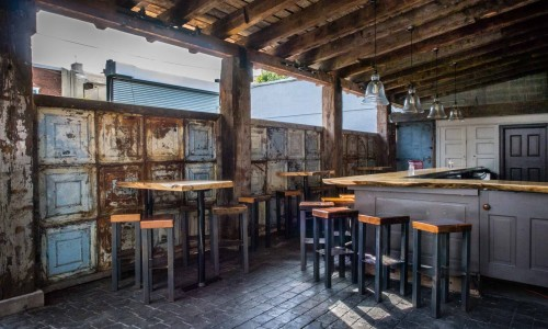 Front Street Cafe features an outdoor dining patio and garden with a secondary bar for the warm weather days.